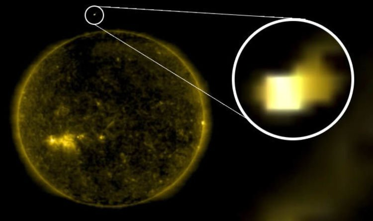 UFO news: Did NASA just film an 'Earth-sized ALIEN CUBE' entering the Sun?