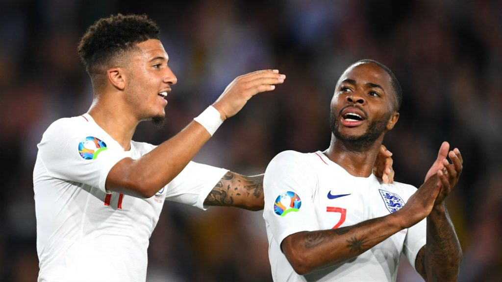 Jadon Sancho and Raheem Sterling celebrate England's fifth goal against Kosovo