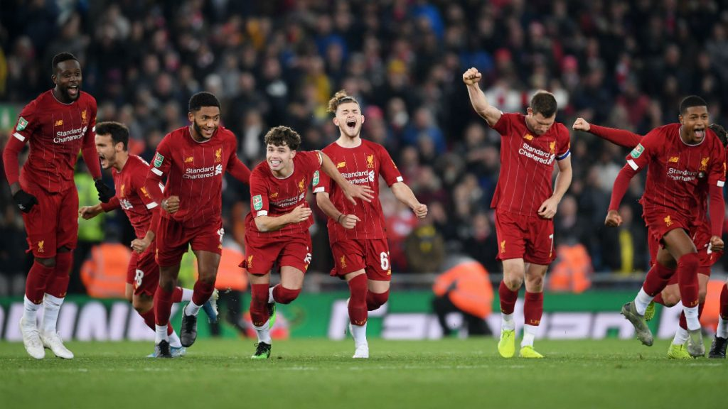 Liverpool players celebrate their Carabao Cup shoot-out victory over Arsenal at Anfield