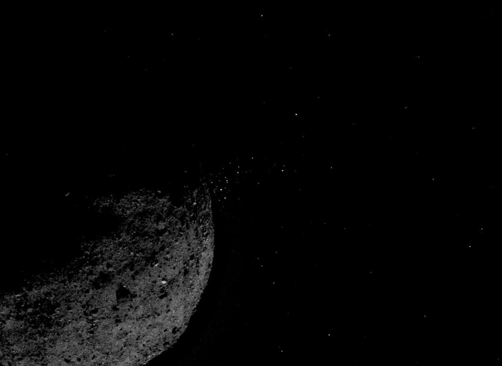 This view of asteroid Bennu ejecting particles from its surface on January 19 was created by combining two images taken on board NASA's OSIRIS-REx spacecraft